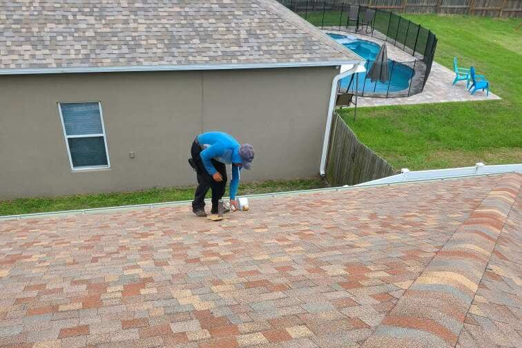 Worker finishing a roof replacement