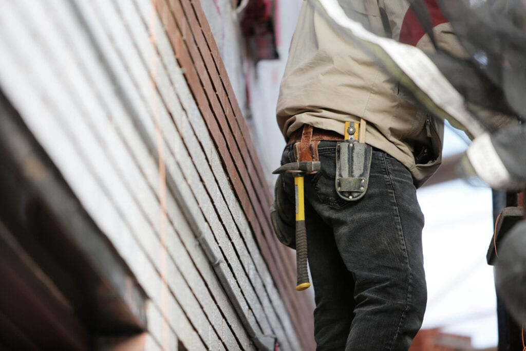 construction workers doing home roofing contract