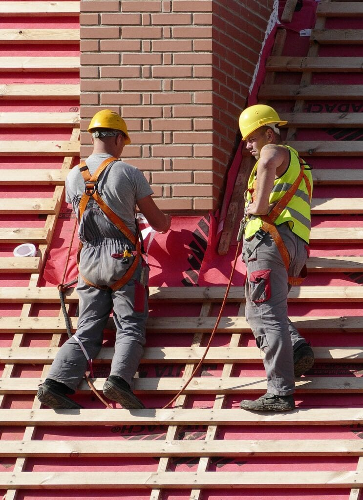 men working on rooftop construction