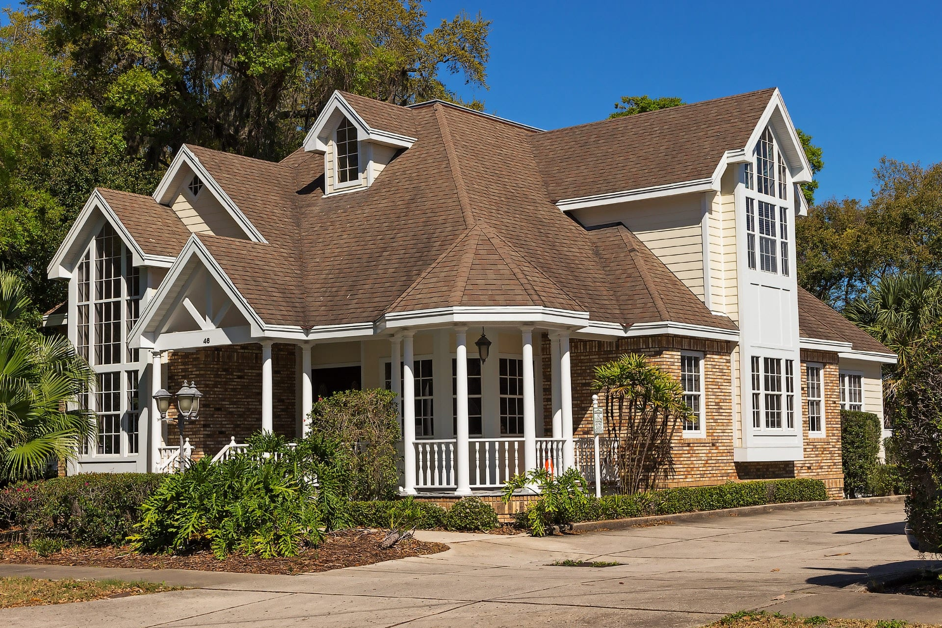 home with very sloped roof for increased cost to replace roof shingles